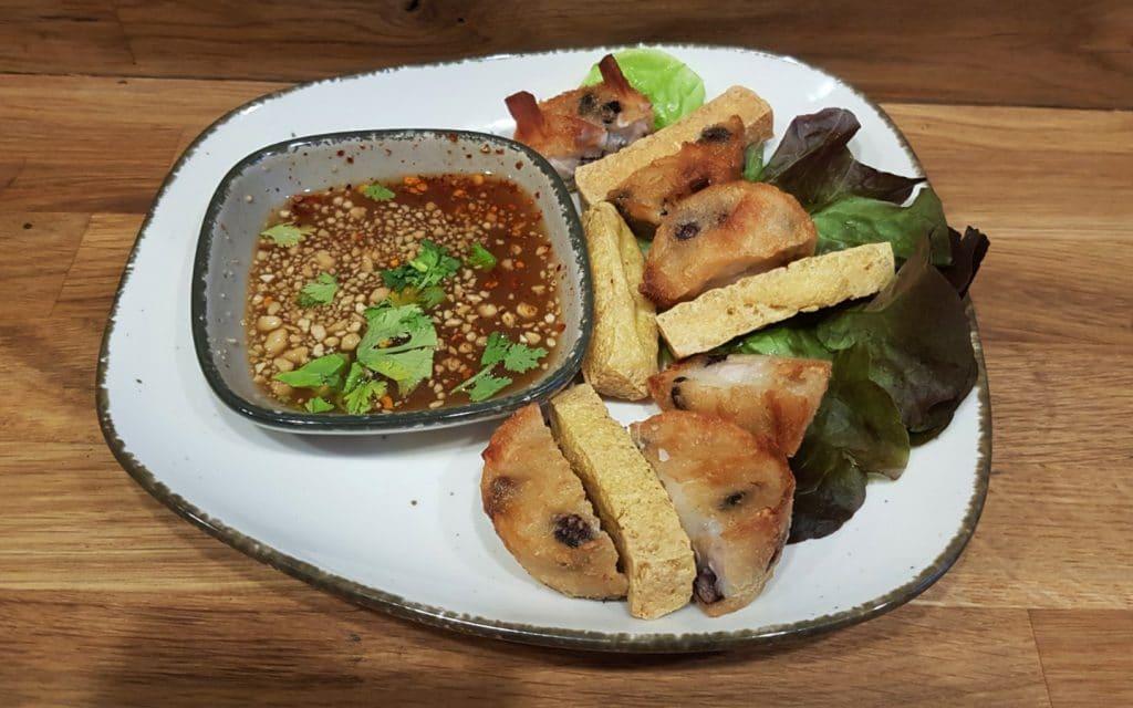 A plate of Thai food Teua Ka Ko, fried cake with taro, tofu, black beans.