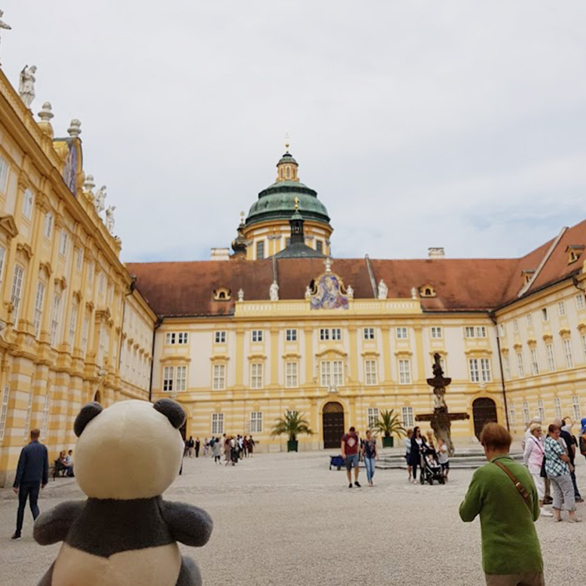 Plushie panda Mister Wong at the square inside of Melk Abbey.