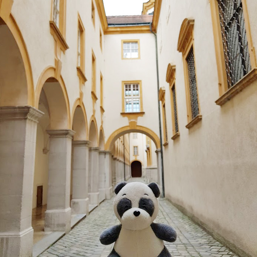 Plushie panda Mister Wong in a side alley of Melk Abbey.