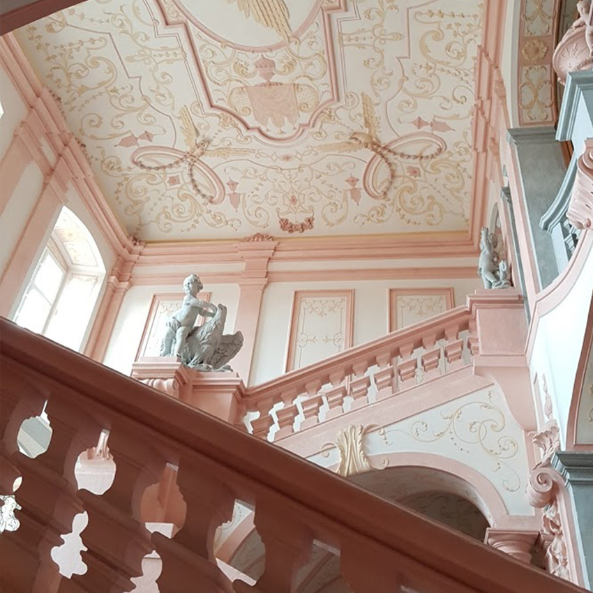 A beautiful staircase inside of Melk Abbey.