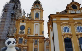 Plushie panda Mister Wong in front of the church inside of Melk Abbey. in the Wachau