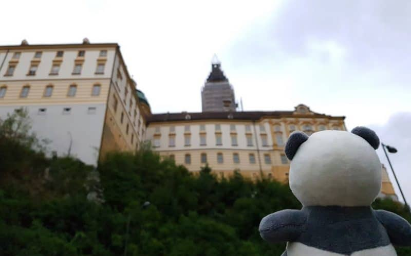 Mister Wong looking up to the back site of Melk Abbey.