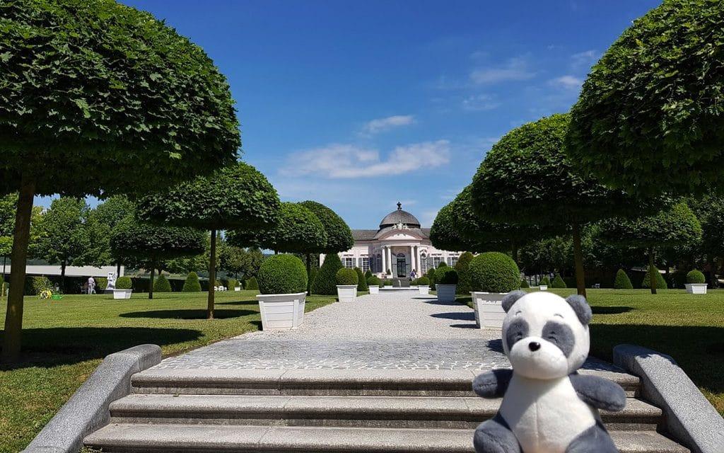 Plushie panda Mister Wong inside of the garden of Melk Abbey.