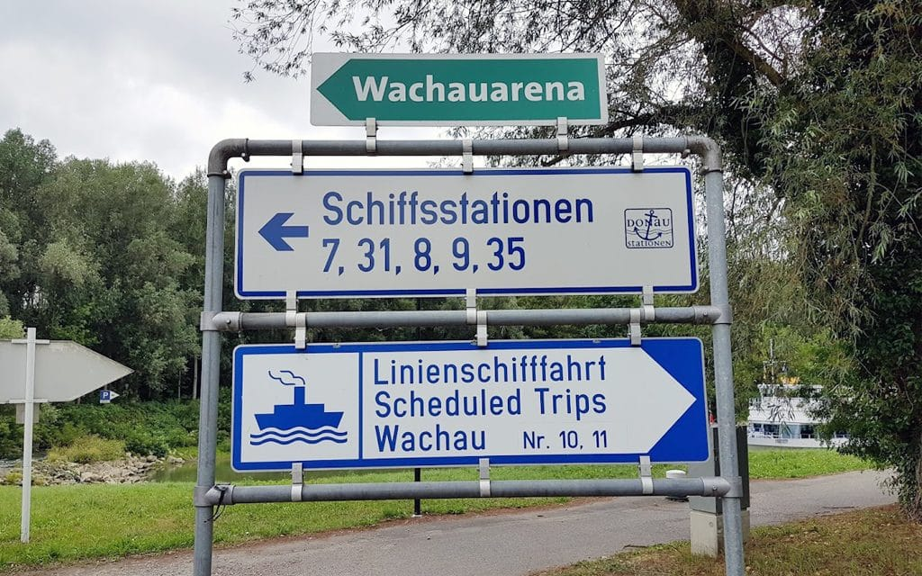 Direction signs which show the way to the pier at the Danube River in Melk.
