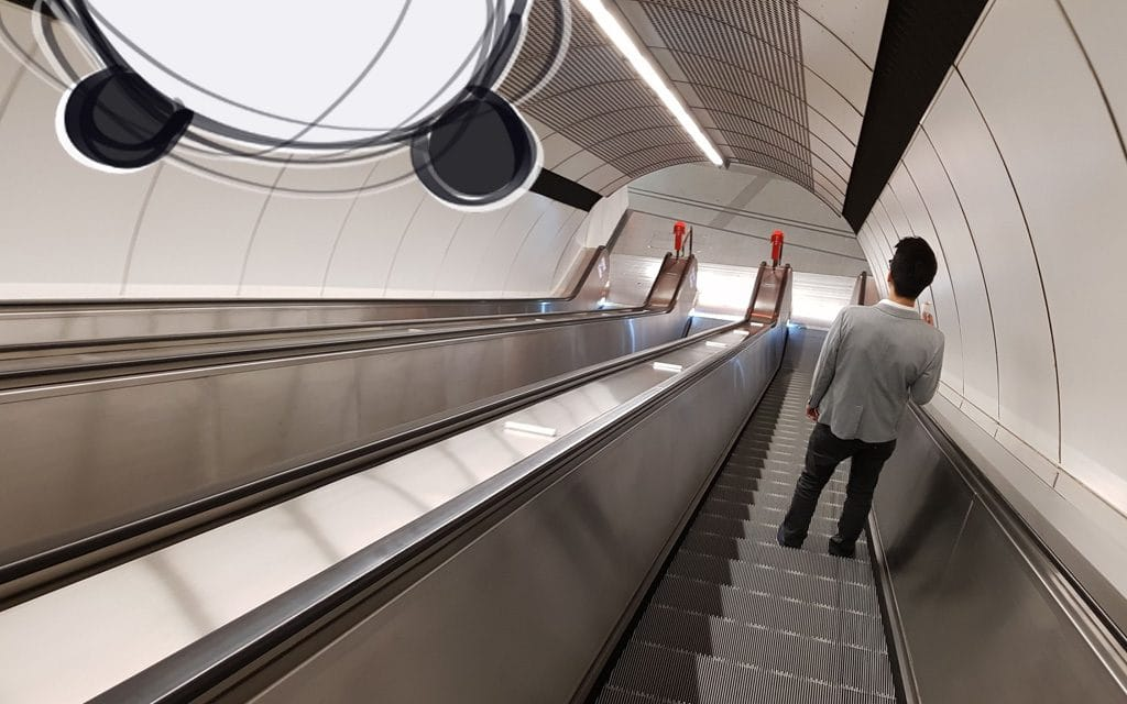 A Viennese standing right on an escalator in a Vienna subway station.