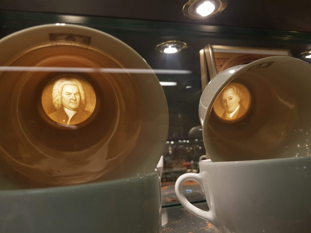 Coffee cups with engravings on the bottom in the Viennese Coffee Museum in Vienna, Austria.