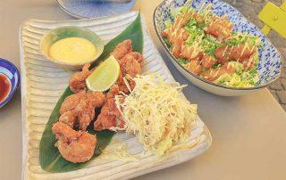 Mister Wong at Japanese Fusion restaurant Mochi in Vienna Austria eating entrees starters California Maki Sushi and Avocado Seaweed Salad