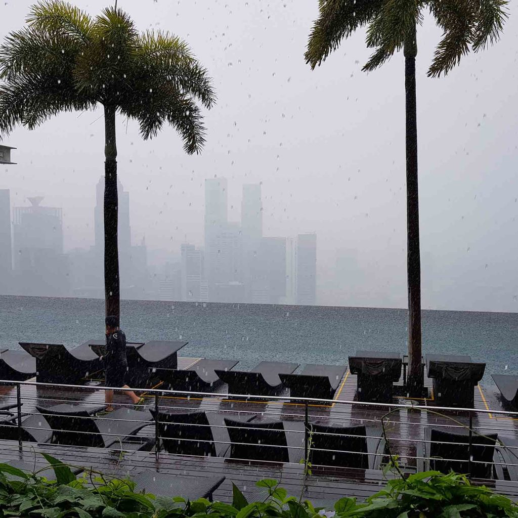 The Infinity Pool on top of Marina Bay Sands Hotel while it is raining, Singapore