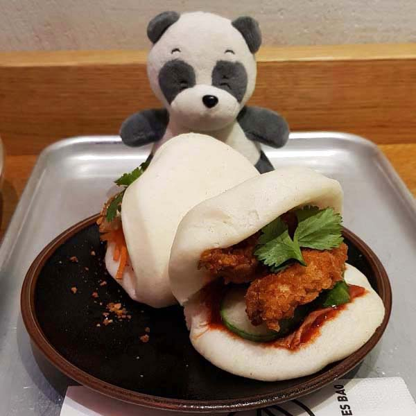 Devouring two delicious Bao.